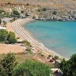 Lindos Beach In Rhodes - Courtesy Of MJJR (Wikimedia Commons)